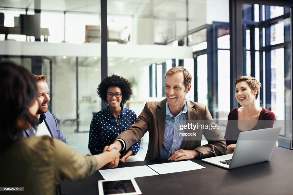 Developing business interests by striking up a deal : Stock Photo