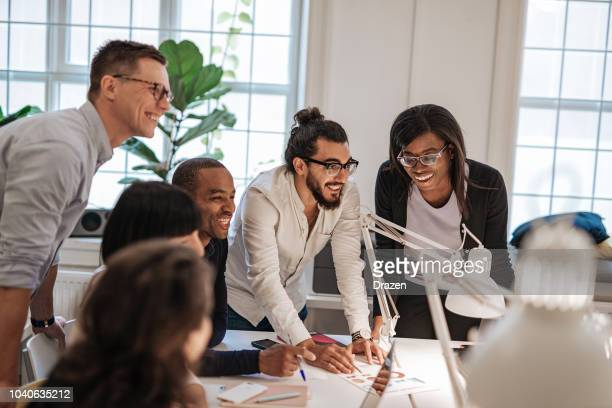 developing fresh ideas for business in multi-ethnic team. - initiative stock pictures, royalty-free photos & images