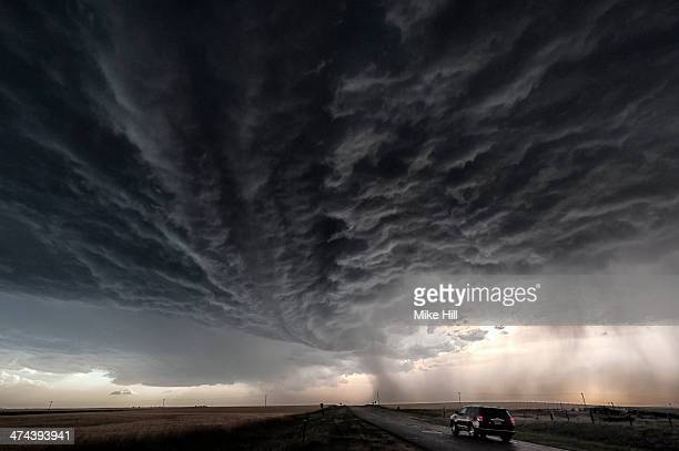 Developing supercell storm over a  country road