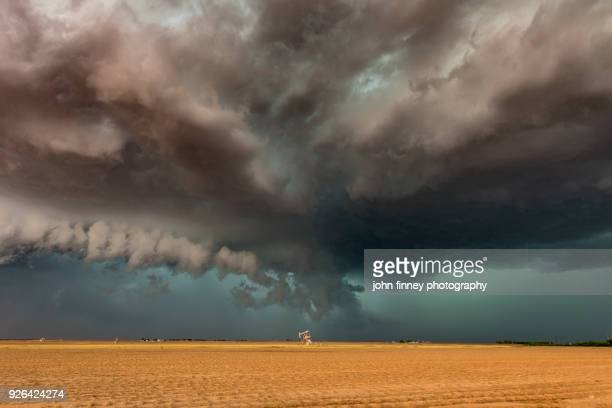 a developing tornado over nodding donkey oil pumps, texas, usa - great plains stock pictures, royalty-free photos & images