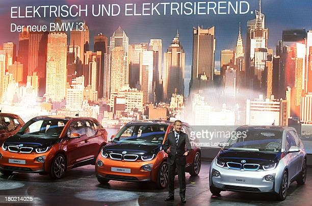 BMW development chief Herbert Diess presents the German car manufacturer's first fully electric car the BMW i3 at the IAA international automobile...