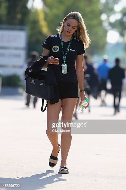 Development driver Carmen Jorda of Spain and Lotus F1 walks through the paddock during previews to the Malaysia Formula One Grand Prix at Sepang...