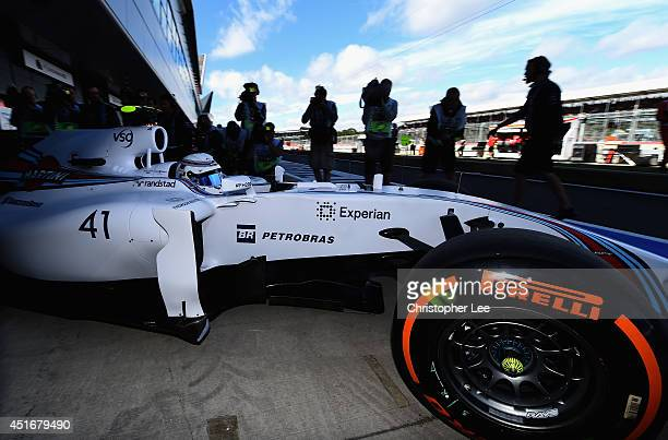 Development driver Susie Wolff of Great Britain and Williams exits the garage during practice ahead of the British Formula One Grand Prix at...