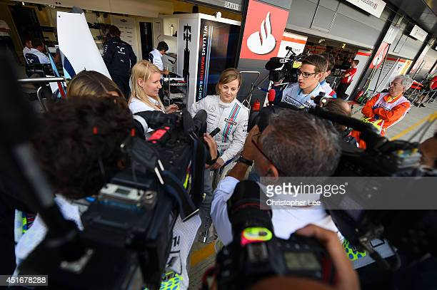 Development driver Susie Wolff of Great Britain and Williams speaks to memebers of the media after practice ahead of the British Formula One Grand...