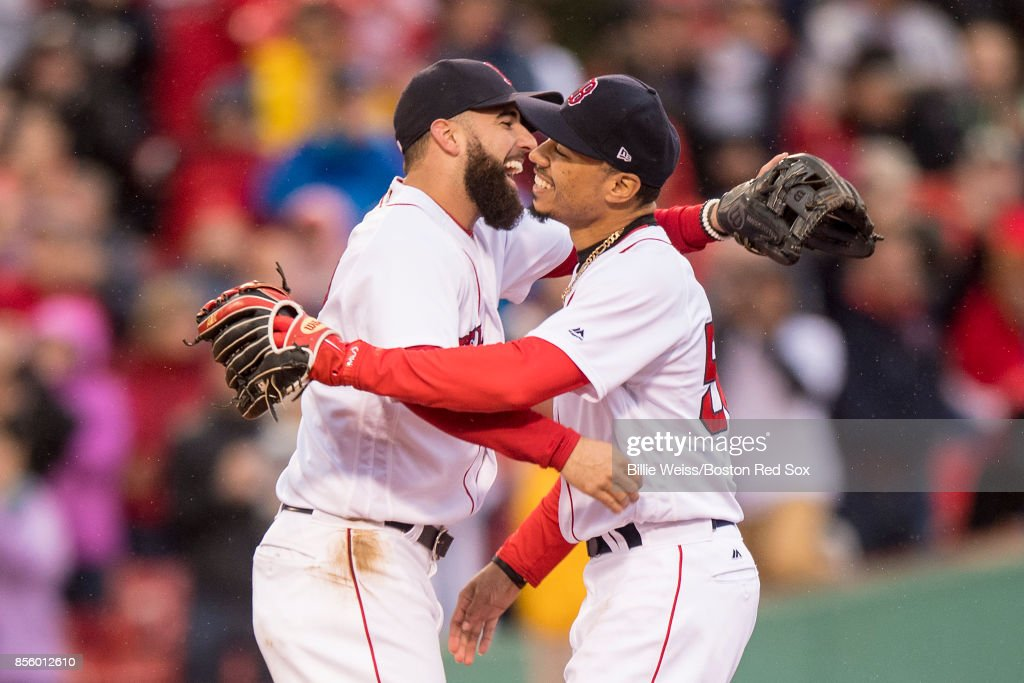 Deven Marrero #17 and Mookie Betts #50 of the Boston Red Sox react after the final out was recorded to clinch the American League East Division against the Houston Astros on September 30, 2017 at Fenway Park in Boston, Massachusetts.