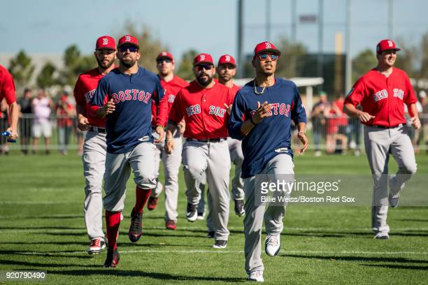Deven Marrero and Mookie Betts of the Boston Red Sox stretch during a team workout on February 19 2018 at jetBlue Park at Fenway South in Fort Myers...