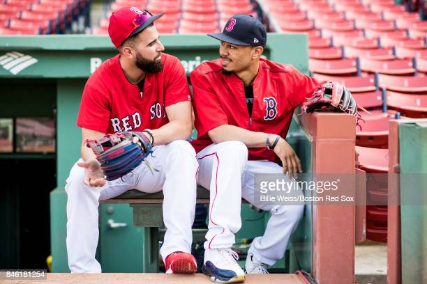Deven Marrero and Mookie Betts of the Boston Red Sox talk before a game against the Oakland Athletics on September 12 2017 at Fenway Park in Boston...