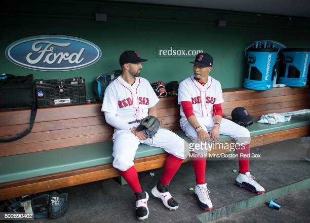 Deven Marrero and Mookie Betts of the Boston Red Sox talk in the dugout before a game against the Minnesota Twins at Fenway Park on June 28 2017 in...