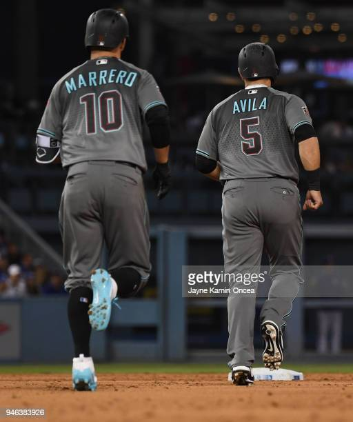 Deven Marrero follows as Alex Avila of the Arizona Diamondbacks runs in front of him after Marrero hit what was initially a threerun home run in the...