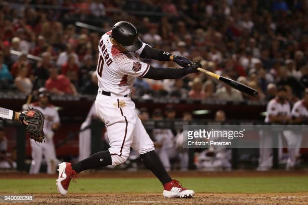 Deven Marrero of the Arizona Diamondbacks hits a RBI single against the Colorado Rockies during the seventh inning of the opening day MLB game at...