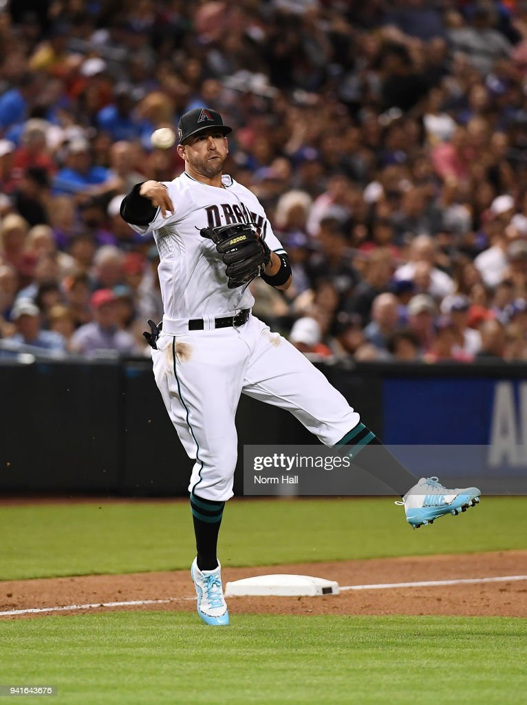 Deven Marrero #10 of the Arizona Diamondbacks makes a running throw to first base for a force out during the sixth inning against the Los Angeles Dodgers at Chase Field on April 3, 2018 in Phoenix, Arizona. Dbacks won 6-1.