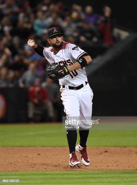 Deven Marrero of the Arizona Diamondbacks makes a running throw to first base against the Los Angeles Dodgers at Chase Field on May 2 2018 in Phoenix...
