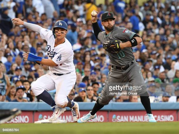 Deven Marrero of the Arizona Diamondbacks takes the throw as Joc Pederson of the Los Angeles Dodgers is thrown out at third by Taijuan Walker of the...