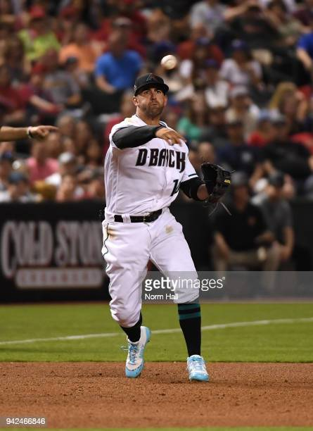 Deven Marrero of the Arizona Diamondbacks throws the ball to first base against the Los Angeles Dodgers at Chase Field on April 3 2018 in Phoenix...