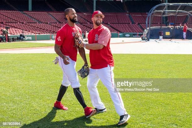 Deven Marrero of the Boston Red Sox reacts with Chris Young before a game against the Texas Rangers on May 24 2017 at Fenway Park in Boston...
