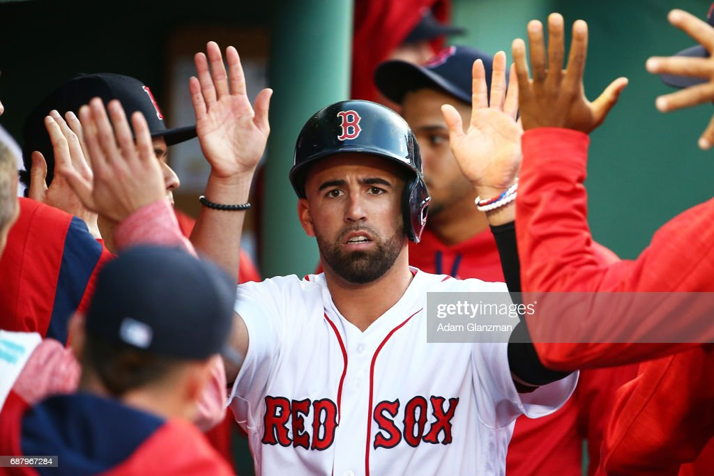 Deven Marrero #17 of the Boston Red Sox returns to the dugout after scoring in the third inning of a game against the Texas Rangers at Fenway Park on May 24, 2017 in Boston, Massachusetts.