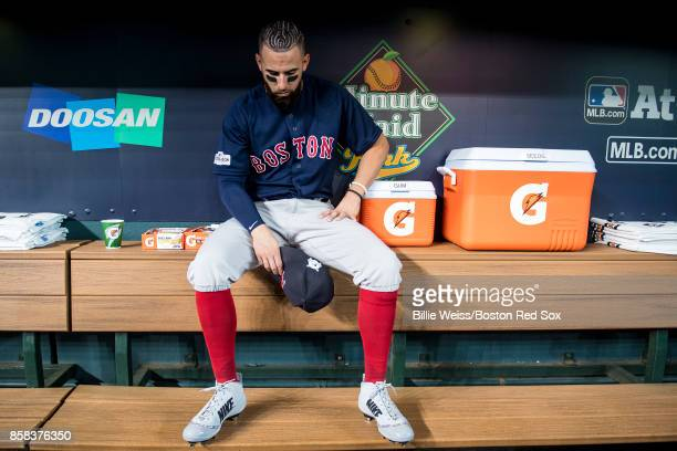 Deven Marrero of the Boston Red Sox sits in the dugout before game two of the American League Division Series against the Houston Astros on October 6...
