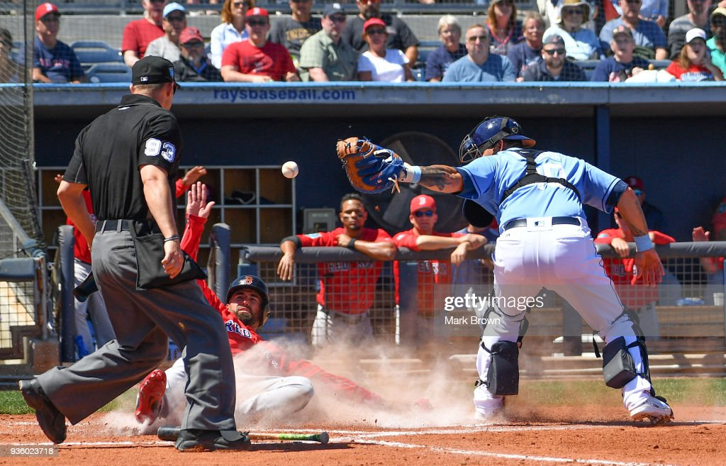 Deven Marrero #17 of the Boston Red Sox slides into home plate in the fourth inning during the spring training game between the Tampa Bay Rays and the Boston Red Sox at Charlotte Sports Park on March 21, 2018 in Port Charlotte, Florida.