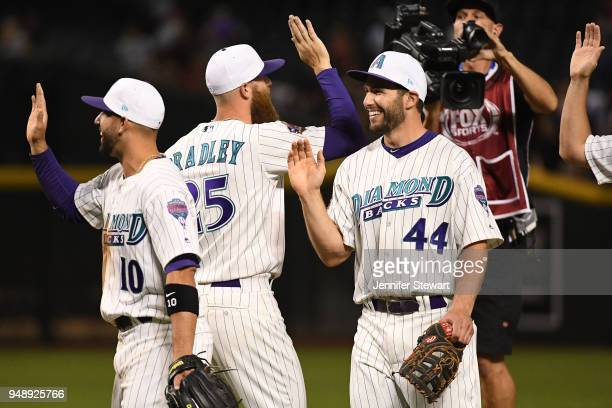 Deven Marrero Paul Goldschmidt and Archie Bradley of the Arizona Diamondbacks celebrate the win over the San Francisco Giants at Chase Field on April...