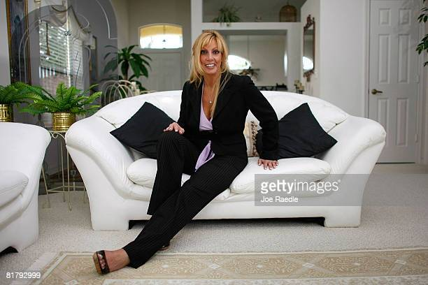 Deven Trabosh sits on a couch in the home that she is offering to sell on Craigslist along with the chance to marry her July 1 2008 in West Palm...