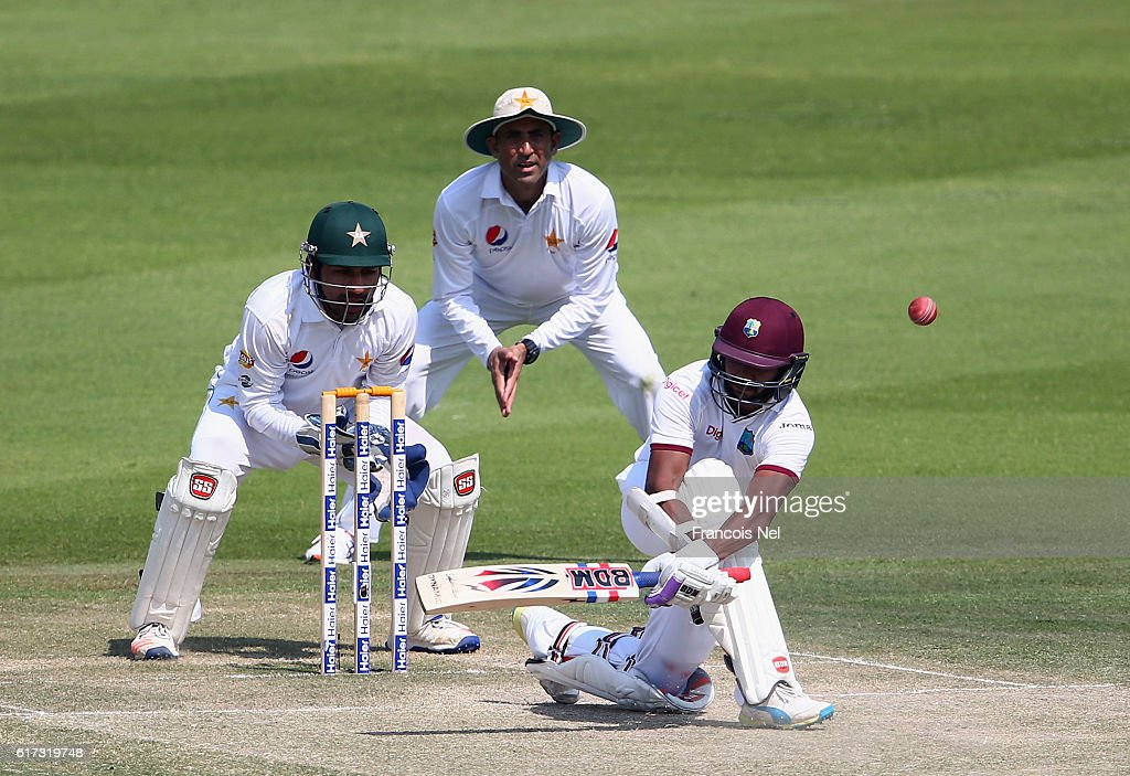 Devendra Bishoo of West Indies bats during Day Three of the Second Test between Pakistan and West Indies at Zayed Cricket Stadium on October 23, 2016 in Abu Dhabi, United Arab Emirates.