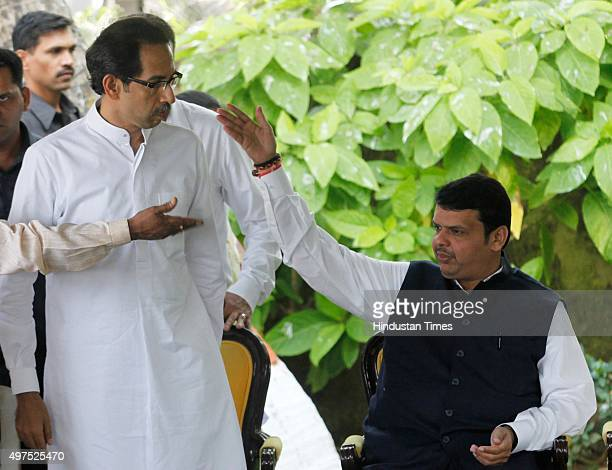 Devendra Fadnavis interacts with Uddhav Thackeray during press conference after paying tribute to Shiv Sena chief Bal Thackeray on his third death...