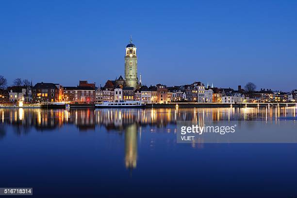 deventer skyline along the ijssel river at night - deventer stock photos and pictures