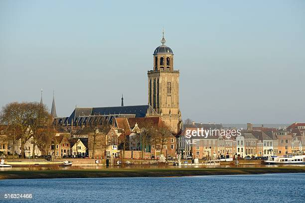deventer skyline along the ijssel river on a sunny day - deventer stock photos and pictures