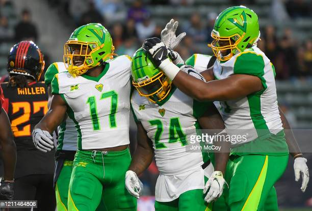 De'Veon Smith is congratulated on scoring a touchdown against the LA Wildcats by Jalen Tolliver and Martez Ivey of the Tampa Bay Vipers at Dignity...