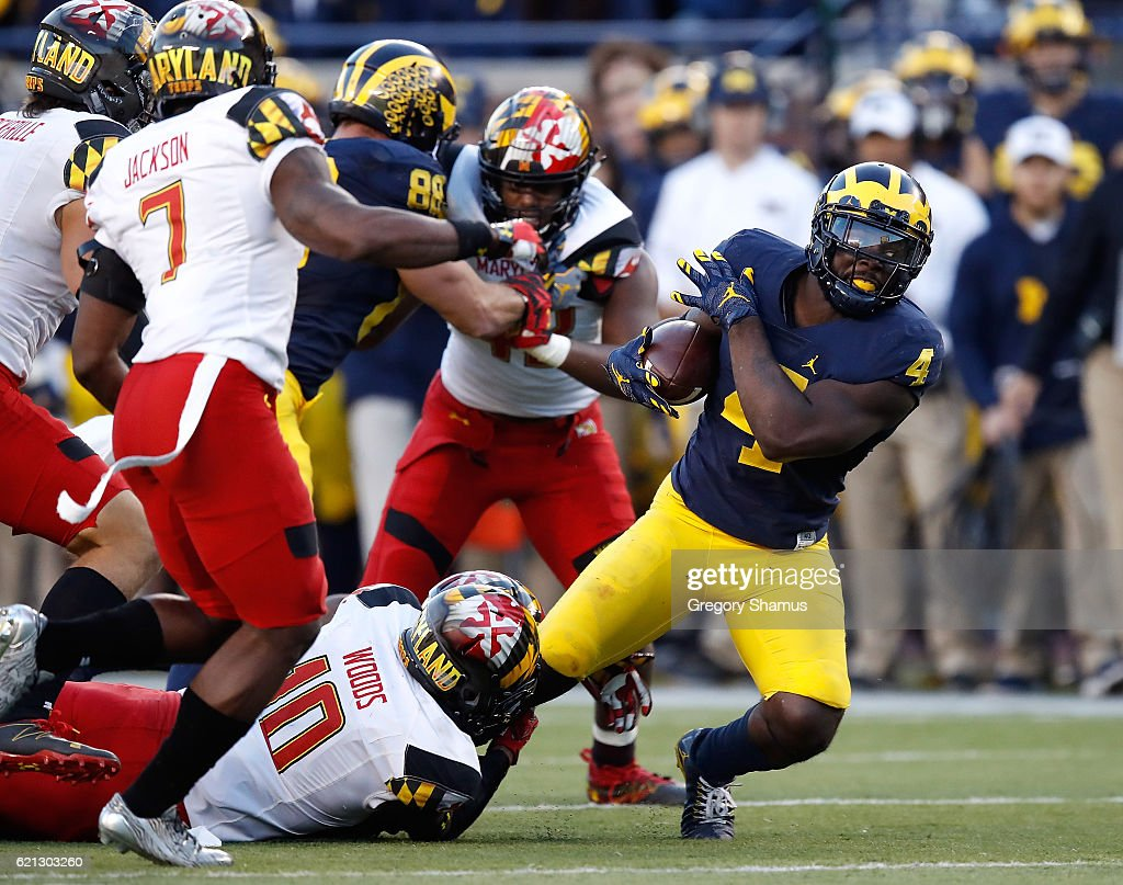 De'Veon Smith #4 of the Michigan Wolverines battles for extra yards during a second half run while playing the Maryland Terrapins on November 5, 2016 at Michigan Stadium in Ann Arbor, Michigan. Michigan won the game 59-3.