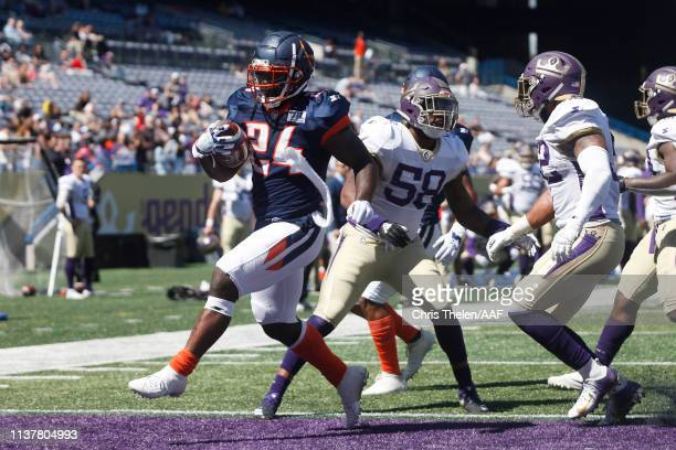 De'Veon Smith of the Orlando Apollos rushes for a 1yard touchdown during the second quarter against the Atlanta Legends in an Alliance of American...