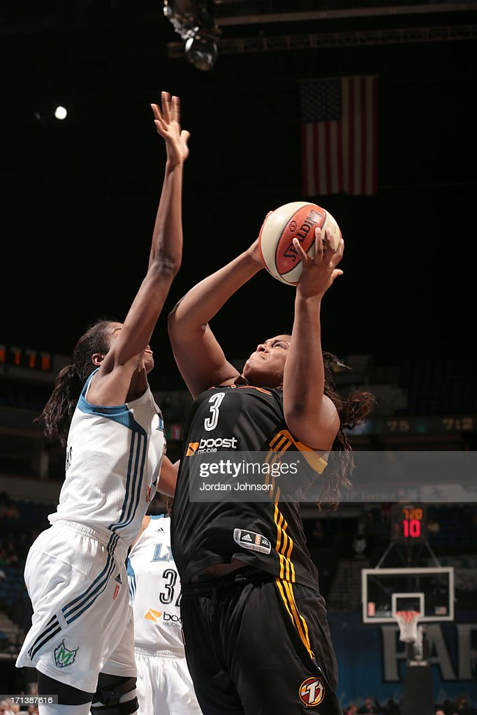 Devereaux Peters #14 of the Minnesota Lynx blocks Courtney Paris #3 of the the Tulsa Shock as she shoots during the WNBA game on June 23, 2013 at Target Center in Minneapolis, Minnesota.