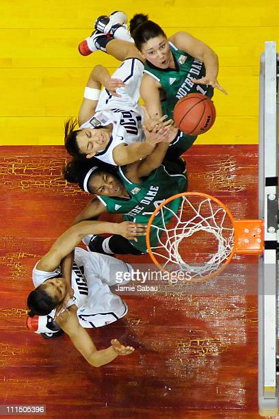 Devereaux Peters of the Notre Dame Fighting Irish and Natalie Achonwa of the Notre Dame Fighting Irish battle for control of the ball with Bria...