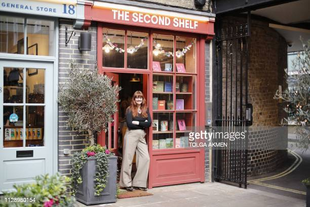 A N Devers author and rare book dealer owner of The Second Shelf poses for a photograph at her bookshop in central London on March 6 2019 The Second...