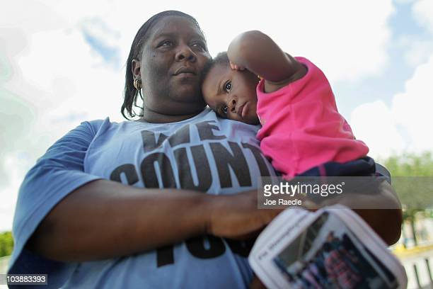 Devetria Stratford holds her daughter Lee Andrea Stratford as she attends a rally asking for Florida Governor Charlie Crist to sign an executive...