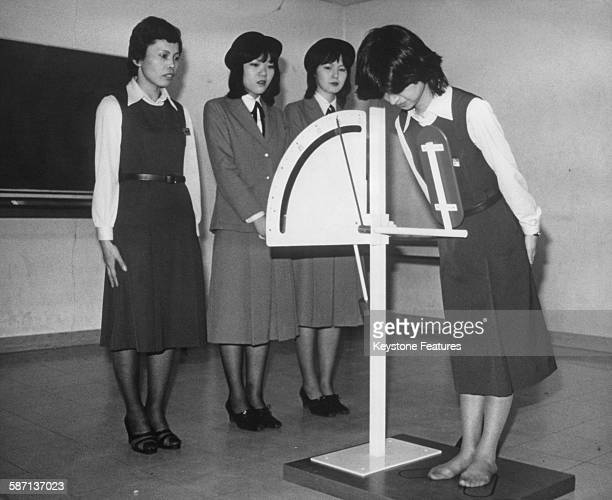 A device to teach young people how to bow correctly developed by a department store in Osaka to train its staff Osaka Japan January 1980 The machine...