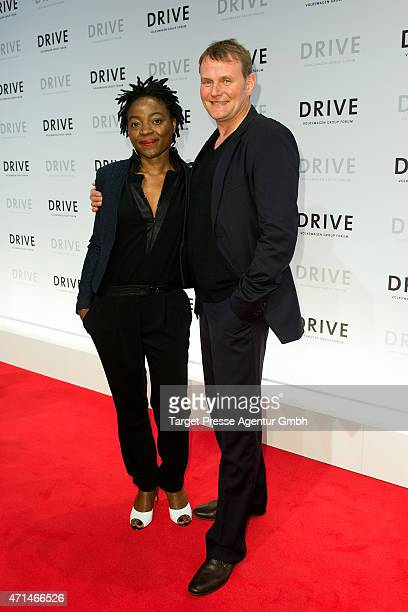 Devid Striesow and his wife Francine attend the DRIVE Volkswagen Group Forum Berlin Opening on April 28 2015 in Berlin Germany