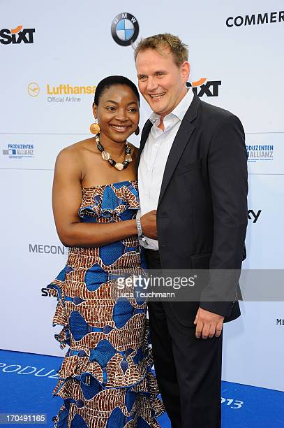 Devid Striesow and wife Francine attends the producer party 2013 of the German producers alliance at Restaurant Auster on June 13 2013 in Berlin...