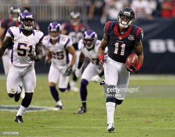 DeVier Posey of the Houston Texans breaks loose from the Minnesota Vikings defens for a 80 yard touchdown run in the second quarter at Reliant...