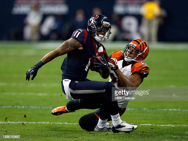 DeVier Posey of the Houston Texans makes a reception against Leon Hall of the Cincinnati Bengals during their AFC Wild Card Playoff Game at Reliant...