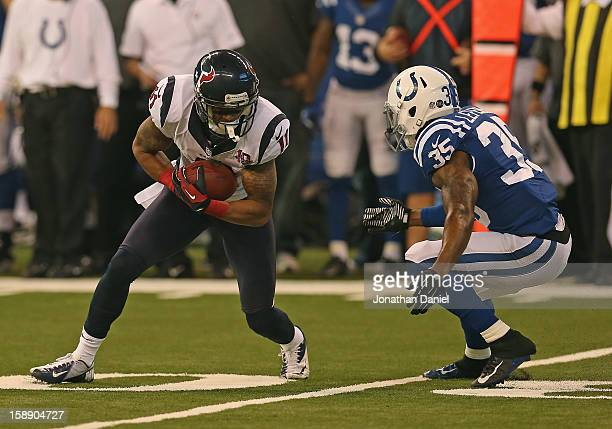 DeVier Posey of the Houston Texans moves against Joe Lefeged of the Indianapolis Colts at Lucas Oil Stadium on December 30 2012 in Indianapolis...