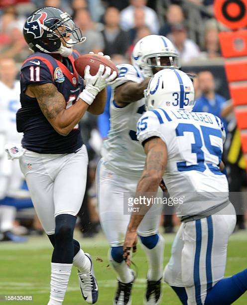 DeVier Posey of the Houston Texans pulls in a pass in front of Joe Lefeged and Cassius Vaughn of the Indianapolis Colts in the first half of their...