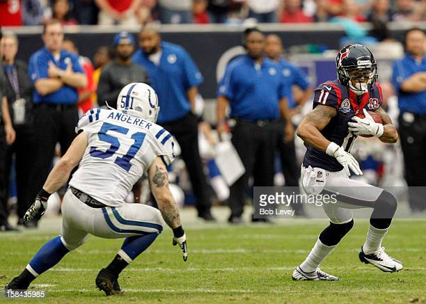 DeVier Posey of the Houston Texans tries to run past Pat Angerer of the Indianapolis Colts in the second half at Reliant Stadium on December 16 2012...