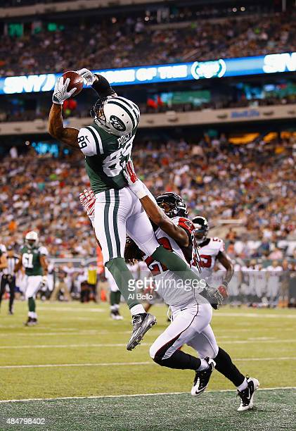 DeVier Posey of the New York Jets scores a touchdown against Dezmen Southward of the Atlanta Falcons in the third quarter during their pre season...