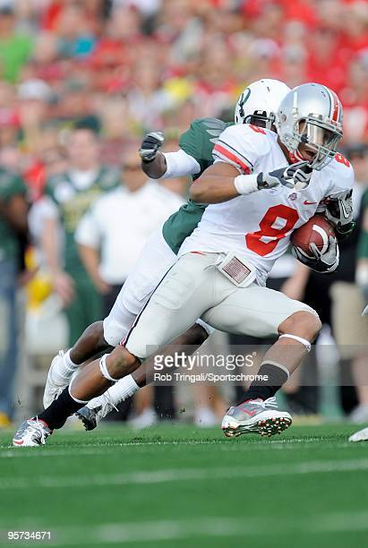 DeVier Posey of the Ohio State Buckeyes runs with the ball against the Oregon Ducks in the 96th Rose Bowl played on January 1 2010 in Pasadena...