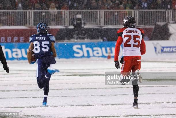DeVier Posey of the Toronto Argonauts outruns Tommie Campbell of the Calgary Stampeders scoring a touchdown after his catch during the first half of...