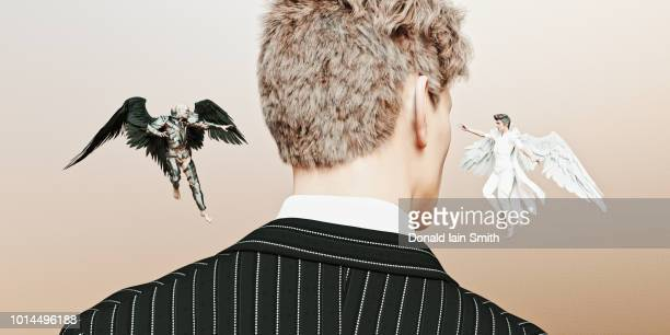 devil and angel whispering in ear of businessman - devil stock pictures, royalty-free photos & images