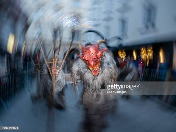 A devil character seen running in the centre of Graz Around December 6th St Nicolas Day people dress up as devils run through streets of towns and...