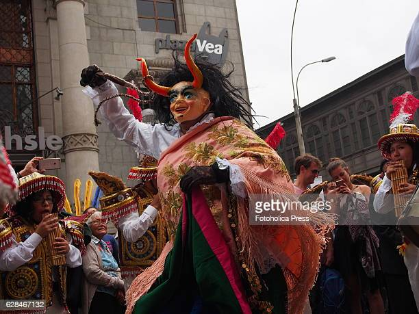 """Devil dancer as part of an Andean folkloric parade and """"morenada"""", a traditional dance, celebrating the day of Our Lady of the Rosary in La Merced..."""