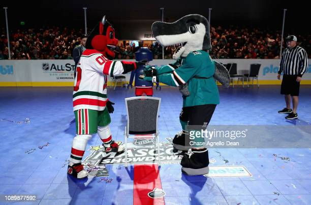 Devil of the New Jersey Devils and SJ Sharkie of the San Jose Sharks attend the 2019 NHL AllStar Fan Fair at the San Jose McEnery Convention Center...
